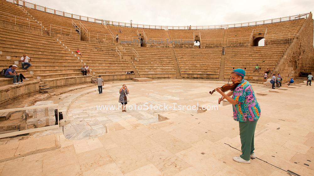 Violinist plays the violin at the Caesarea amphitheater