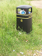 Litter bin nearly full of rubbish, UK