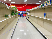 """15 MARCH 2020 - ALTOONA, IOWA: Customers walk through the stripped bare shelves of toilet paper and cleaning products at the Target store in Altoona. Iowans started hoarding paper products and canned goods over the weekend as fears of coronavirus caused shortages spread. The Governor of Iowa announced Saturday night that the Coronavirus in Iowa had entered the """"community spread"""" phase when a person in Dallas County, in the Des Moines metropolitan area, tested positive for Coronavirus. As of Sunday morning, Iowa was reporting 18 people tested positive for Coronavirus.              PHOTO BY JACK KURTZ"""