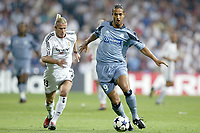Fotball<br /> UEFA Champions League 2003/2004<br /> 16.09.2003<br /> Real Madrid v Olympique Marseille<br /> NORWAY ONLY<br /> Foto: Digitalsport<br /> <br /> FOOTBALL - CHAMPIONS LEAGUE 2003/04 - 1ST ROUND - 030916 - REAL MADRID v OLYMPIQUE MARSEILLE - MIDO (OM) / DAVID BECKHAM (REAL) - PHOTO JEAN MARIE HERVIO