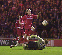 Photo. Glyn Thomas.<br /> Middlesbrough v Arsenal. Carling Cup semi final second leg. <br /> Riverside Stadium, Middlesbrough. 03/02/2004.<br /> Boro's Bolo Zenden (C) puts his side a goal in front as he sends the ball over the diving Arsenal keeper Graham Stack.