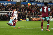 Mark Noble of West Ham Utd acrobatically kicks the ball clear. Barclays Premier league match, Swansea city v West Ham Utd at the Liberty Stadium in Swansea, South Wales  on Sunday 20th December 2015.<br /> pic by  Andrew Orchard, Andrew Orchard sports photography.