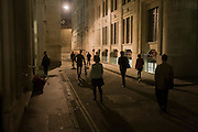 Psychogeographers in the City of London while following the route of the former River Walbrook along Tokenhouse Yard during a walk by the writer Tom Chivers.