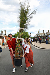 © Licensed to London News Pictures. 25/05/2019. London, UK. Visitors to the RHS Chelsea Flower Show carry wide variety of striking plants and flowers sold off cheap by the exhibitors on the final day of the show. The Royal Horticultural Society Chelsea Flower Show is an annual garden show held in the grounds of the Royal Hospital Chelsea in West London since 1913. Photo credit: Dinendra Haria/LNP
