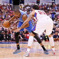 11 May 2014: Oklahoma City Thunder forward Kevin Durant (35) drives past Los Angeles Clippers forward Matt Barnes (22) during the Los Angeles Clippers 101-99 victory over the Oklahoma City Thunder, during Game Four of the Western Conference Semifinals of the NBA Playoffs, at the Staples Center, Los Angeles, California, USA.