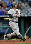 April 12, 2009:  First basemen Nick Swisher #33 of the New York Yankees drives the ball to center field against the Kansas City Royals at Kauffman Stadium in Kansas City, Missouri.  The Royals defeated the Yankees 6-4.