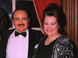 Middle Eastern arms dealer MR ADNAN KHASHOGGI and his former wife MRS SORAYA KHASHOGGI. at a wedding in London on 6th December 1997. MED 95