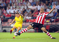 Photo: Chris Ratcliffe.<br /> PSV Eindhoven v Liverpool. UEFA Champions League, Group C. 12/09/2006.<br /> Craig Bellamy of Liverpool tries to get a shot in as Alex of PSV Eindhoven closes him down.