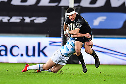 Ospreys' Kieron Fonotia is tackled by Leinster's Rory O'Loughlin<br /> <br /> Photographer Craig Thomas/Replay Images<br /> <br /> Guinness PRO14 Round 18 - Ospreys v Leinster - Saturday 24th March 2018 - Liberty Stadium - Swansea<br /> <br /> World Copyright © Replay Images . All rights reserved. info@replayimages.co.uk - http://replayimages.co.uk