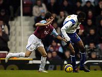 Photo: Olly Greenwood.<br />West Ham United v Portsmouth. The Barclays Premiership. 26/12/2006. Portsmouth's Kwankwo Kanu goes past West Ham's Yossi Benayoun