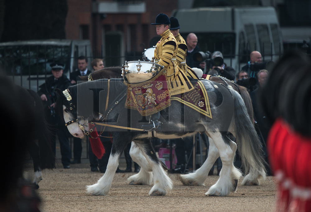 © London News Pictures 20/10/2015. Drum Horses Adamas and Mercury enter Horse Guards Parade.<br /> <br /> More than 1,100 soldiers and 230 horses joined HM The Queen, HRH The Duke of Edinburgh, The Duke and Duchess of Cornwall, the Prime Minister, Senior members of the Cabinet, the Lord Mayor of London, the Mayor of London, and the Defence Chiefs of Staff for the ceremonial welcome to Britain of The President of The People's Republic of China and Madame Peng Liyuan . Photo credit: Rupert Frere/LNP