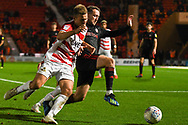 Herbie Kane of Doncaster Rovers (15) is tackled by Aidan McGeady of Sunderland (19) during the EFL Sky Bet League 1 match between Doncaster Rovers and Sunderland at the Keepmoat Stadium, Doncaster, England on 23 October 2018.