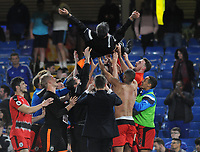 Football - 2017 / 2018 Premier League - Chelsea vs. Huddersfield Town<br /> <br /> Huddersfield Manager, David Wagner, is thrown in the air by his players after surviving in the Premiership for next season at Stamford Bridge.<br /> <br /> COLORSPORT/ANDREW COWIE