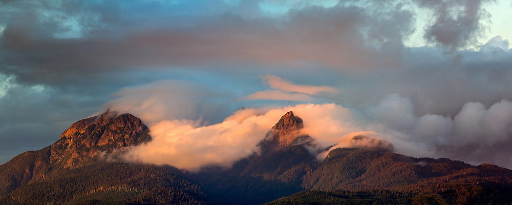 Sunset light hits the clouds clearing from Mount Blanshard (The Golden Ears) - photographed from Tavistock Point at Brae Island Regional Park in Langley, British Columbia, Canada