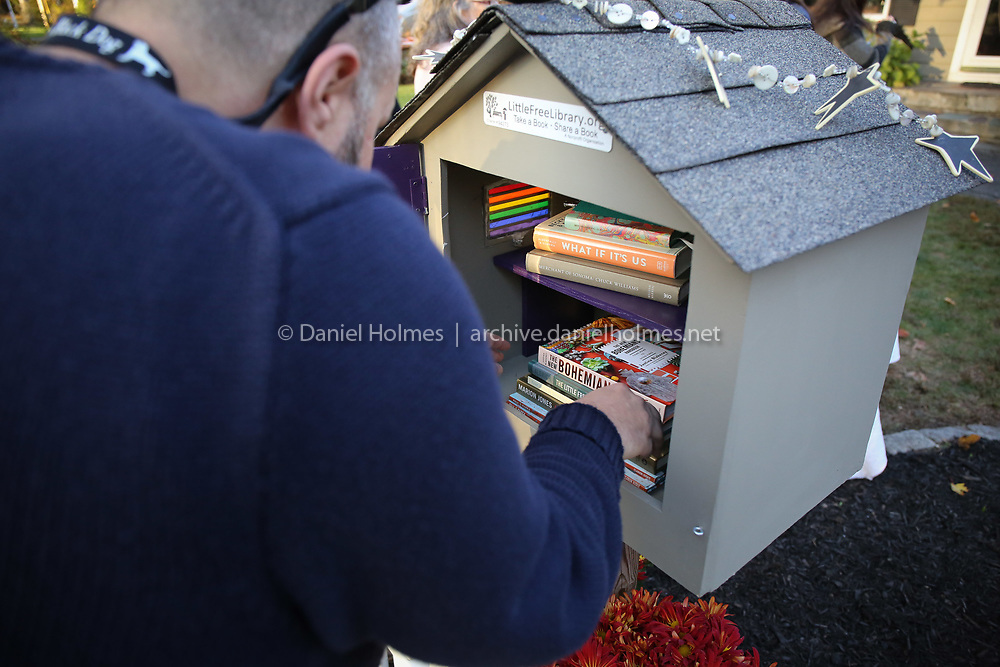 (11/3/19, FRAMINGHAM, MA) Drew Giovannini stocks the  Little Free Library on McPhee Rd. in Framingham on Sunday. [Daily News and Wicked Local Photo/Dan Holmes]