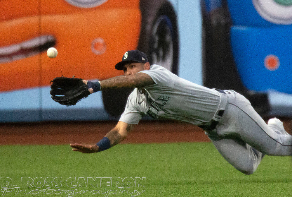 Sep 16, 2020; San Francisco, CA, USA; Seattle Mariners left fielder Tim Lopes (10) dives in vain for a double off the bat of San Francisco Giants Brandon Crawford during the second inning of a baseball game at Oracle Park. Mandatory Credit: D. Ross Cameron-USA TODAY Sports