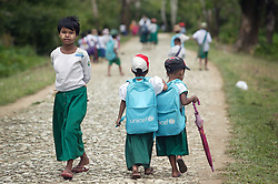 Children wearing UNICEF school bags head home for their lunch from the primary school in Laputtaloke Taung village close to Lamputta, Myanmar.