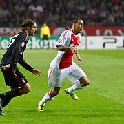 NLD/Amsterdam/20100928 - Champions Leaguewedstrijd Ajax - AC Milan, Gregory van der Wiel in duel met Alessandro Nesta