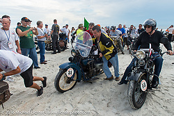 Clyde Crouch with his 1929 Henderson KJ and Bartek Mizerski with his 1936 Sokol 1000 Polish motorcycle pass through the start on the sands of Daytona Beach at the beginning of stage 1 of the Motorcycle Cannonball Cross-Country Endurance Run, which on this day ran from Daytona Beach to Lake City, FL., USA. Friday, September 5, 2014.  Photography ©2014 Michael Lichter.