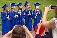 New Windsor, New York - Girls line up for photographs after Hudson Hills Academy held its Primary School graduation ceremony on Wednesday, June 11, 2014. The children completed a Montessori program at the school ©Tom Bushey / The Image Works