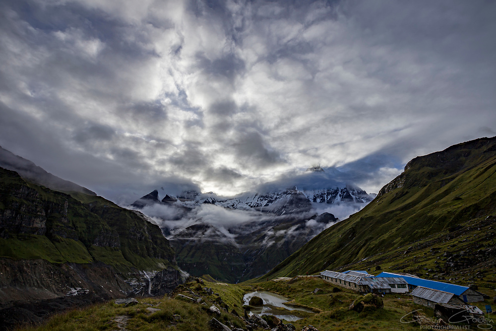 A view from above the Base Camp accommodation buildings towards the sacred mountain of Machapuchare, Annapurna Base Camp, Annapurna Sanctuary Trek, Nepal