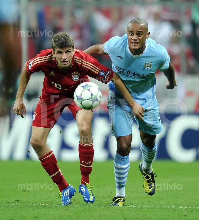 FUSSBALL   CHAMPIONS LEAGUE   SAISON 2011/2012     27.09.2011 FC Bayern Muenchen - Manchester City FC Thomas Mueller (li, FC Bayern Muenchen) gegen Vincent Kompany (Manchester City)
