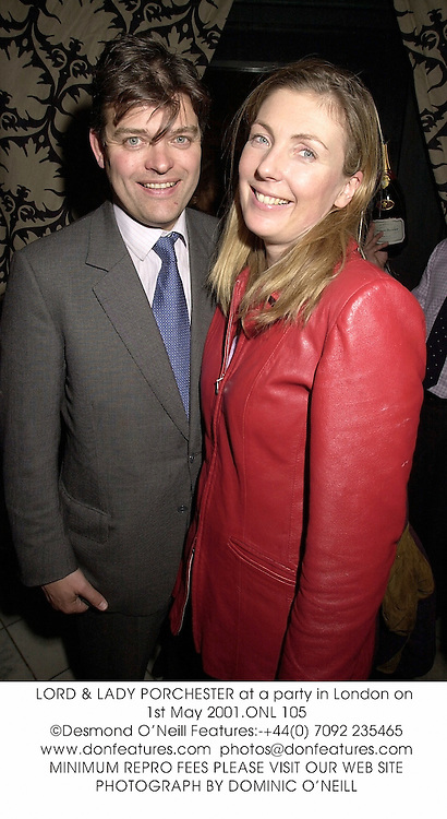 LORD & LADY PORCHESTER at a party in London on 1st May 2001.ONL 105