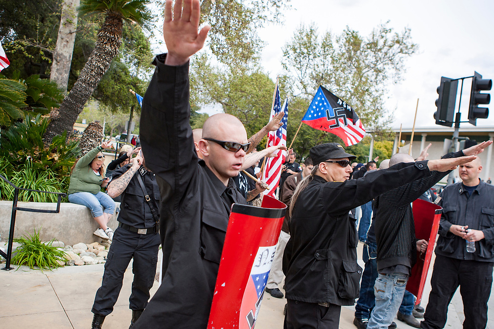 Members of the National Socialist Movement, a Neo Nazi group, rallies in Claremont, California against illegal immigration. Police ready to escort the NSM out of the demonstration zone to protect against confrontation with counter protesters.