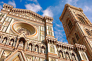 The Dome Catheral - Detail Of facade and bell tower ; Florence Italy .<br /> <br /> Visit our ITALY PHOTO COLLECTION for more   photos of Italy to download or buy as prints https://funkystock.photoshelter.com/gallery-collection/2b-Pictures-Images-of-Italy-Photos-of-Italian-Historic-Landmark-Sites/C0000qxA2zGFjd_k<br /> .<br /> <br /> Visit our MEDIEVAL PHOTO COLLECTIONS for more   photos  to download or buy as prints https://funkystock.photoshelter.com/gallery-collection/Medieval-Middle-Ages-Historic-Places-Arcaeological-Sites-Pictures-Images-of/C0000B5ZA54_WD0s