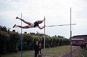 Boy competing in pole vault event at secondary school sports day, Ilford County High school, Essex,  England in 1965