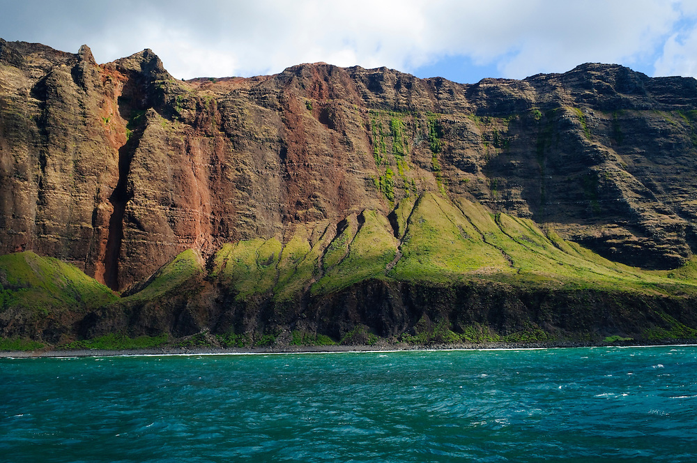 The famous Na Pali coast of Kauai seen from offshore. This terrain, on the northwest shore of the island, has been the setting for scenes in a variety of movies including Jurassic Park, King Kong, and Raiders of the Lost Ark.<br /> (Kauai, USA - September 2011)