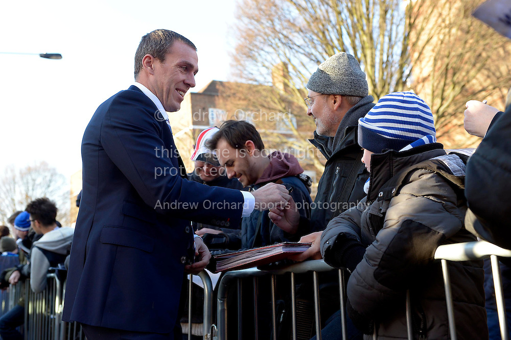 Richard Dunne of QPR signing autographs outside Loftus Road Ground before k/o. Barclays Premier league match, Queens Park Rangers v Crystal Palace at Loftus Road in London on Sunday 28th December 2014.<br /> pic by John Patrick Fletcher, Andrew Orchard sports photography.