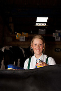 A young girl preparing for the heifer class. The hairdryers are out and the shampoo is flowing at the Great Yorkshire Show, one of Britain's biggest agricultural shows. Its famous for its competitive displays of livestock. The event, established in 1837, attracts over 125 000 visitors a year and has over 10 000 entries to its pedigree competitions ranging from pigeons and rabbits to bulls and shire horses. At the heart of the show is the passion of the exhibitors who spend hundreds of hours ( and pounds)  training, preparing and grooming their animals. As one competitor put it ?I'm proud to say that the cattle are my friend, I have had cattle who have died and I have sat down and wept for them?