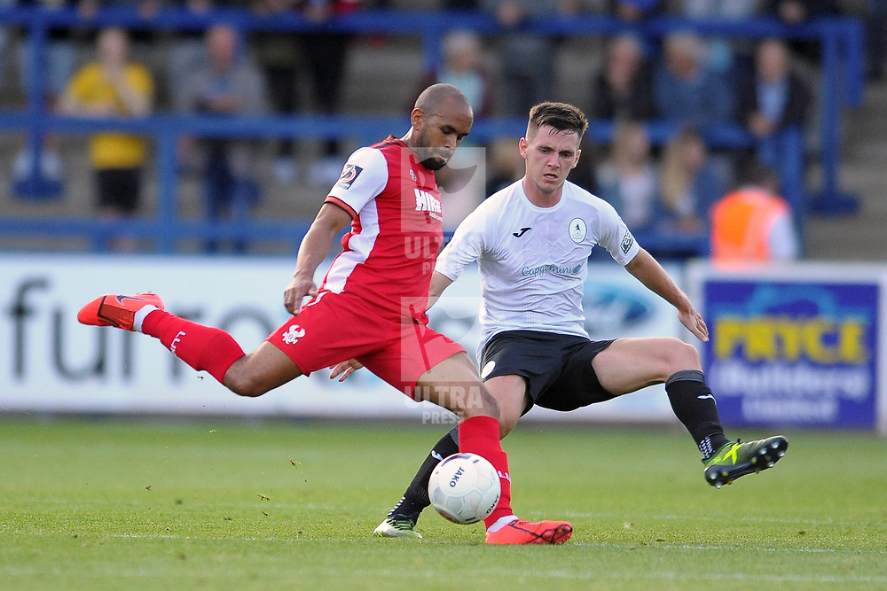 TELFORD COPYRIGHT MIKE SHERIDAN Edward Williams is closed down by telford's Ross White during the National League North fixture between AFC Telford United and Kidderminster Harriers on Tuesday, August 6, 2019.<br /> <br /> Picture credit: Mike Sheridan<br /> <br /> MS201920-006