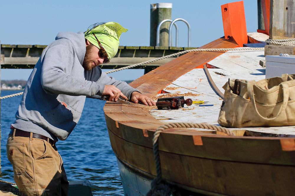 Shipwright apprentice Simon Tomko works to restore the Skipjack Caleb W. Jones at the Chesapeake Bay Maritime Museum in St. Michael?s, Maryland. The Caleb W. Jones was originally built in 1953 in Reedeville, Virginia