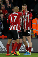 Sheffield United's Oliver McBurnie celebrates with teammates after scoring the opening goal <br /> <br /> Photographer Rich Linley/CameraSport<br /> <br /> The Premier League - Sheffield United v West Ham United - Friday 10th January 2020 - Bramall Lane - Sheffield <br /> <br /> World Copyright © 2020 CameraSport. All rights reserved. 43 Linden Ave. Countesthorpe. Leicester. England. LE8 5PG - Tel: +44 (0) 116 277 4147 - admin@camerasport.com - www.camerasport.com