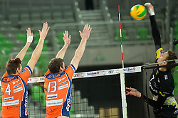 Jan Kozamernik of ACH and Eric Mochalski of ACH vs Damian Schulz of Lotos Trefl Gdansk during volleyball match between ACH Volley (SLO) and Lotos Trefl Gdansk (POL) in 3rd Leg of Pool F of 2016 CEV DenizBank Volleyball Champions League, on December 3, 2015 in Arena Stozice, Ljubljana, Slovenia. Photo by Vid Ponikvar / Sportida