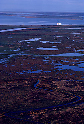 Stock photo of a barge in the distance of a wetland marsh