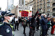 Protestors are seen crowding despite the social distancing measures put in place to prevent the spread of COVID-19 on 06 June, 2020 in Melbourne, Australia. This event was organised to rally against aboriginal deaths in custody in Australia as well as in unity with protests across the United States following the killing of an unarmed black man George Floyd at the hands of a police officer in Minneapolis, Minnesota. (Photo by Mikko Robles/ Speed Media)