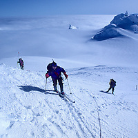 CORD.SARMIENTO, Rob Hart (MR) skis to summit of 2nd highest peak in Patagonian range (Chile).