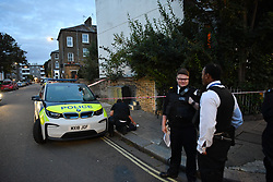 © Licensed to London News Pictures. 25/09/2019. London, UK. Police investigate the scene of an alleged abduction on the junction of Goodwin and Boscombe Road outside the Crown and Sceptre Pub in Shepherds Bush. Eyewitnesses described how a male was beaten by a group of men before being bundled into a car and driven away at speed. Photo credit: Guilhem Baker/LNP