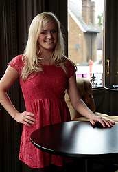 """© Licensed to London News Pictures. 16/07/2012. London, England. Pictured: Rachael Wooding (Jersey Boys, Hairspray). On Thursday, 19th July, Gareth Gates, Jonathan Ansell, Daniel Boys, Emma Williams and Rachael Wooding perform in """"Momentous Musicals"""", a brand new concert celebration showcasing ballads and songs from musicals for one night only at the New Wimbledon Theatre, London. The show is directed by John Garfield-Roberts with musical direction by John Dyer. Photo credit: Bettina Strenske/LNP"""