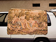 Tapestry for sale on van in brocant boot fair, 27th December 2016, Lagrasse France.