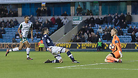 Football - 2017 / 2018 FA Cup - Third Round: Millwall vs. Barnsley<br /> <br /> Adam Davies (Barnsley FC) makes a save from the sliding Conor McLaughlin (Millwall FC) at The Den.<br /> <br /> COLORSPORT/DANIEL BEARHAM