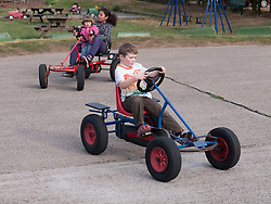 Children on pedal-operated go-carts