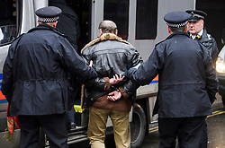 © Licensed to London News Pictures. 08/04/2018. London, UK. A man being arrested by police after being found carrying what appears to be a weapon at an anti-semitism demonstration outside the headquarters of the Labour Party, in London. Labour party leader Jeremy Corbyn recently apologised for what he described as 'pockets' of anti-Semitism within Labour Party. Photo credit: Ben Cawthra/LNP