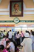28 MARCH 2012 - HO CHI MINH CITY, VIETNAM:    A portrait of Ho Chi Minh hanging in the main post office in Ho Chi Minh City, Vietnam. The main Post Office is a landmark and popular with tourists who visit Vietnam.     PHOTO BY JACK KURTZ