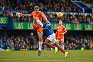 Blackpool Defender, Nick Anderton (3) beats Portsmouth Midfielder, Jamal Lowe (10) to the ball during the EFL Sky Bet League 1 match between Portsmouth and Blackpool at Fratton Park, Portsmouth, England on 12 January 2019.