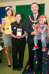 Julie and Deborah Cooper who are both Weight watchers group leaders for the Rotherham Area were Joined by the mayor of Rotherham Cllr Shaun Wright holding young patient Finley Clements...Weight Watchers Give away Easter Eggs 120514..http://www.pauldaviddrabble.co.uk.29 March 2012 .Image © Paul David Drabble