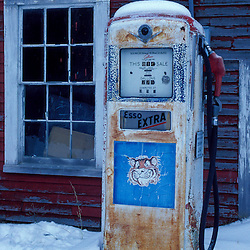 Barns. Gas Pumps. Esso Extra at the Pinestead Farm Lodge.  Franconia, NH